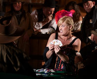 Woman Playing Cards in Saloon Royalty Free Stock Image