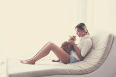 Woman playing with a cat Royalty Free Stock Photo