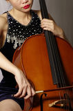 Woman playing cello. Close up of woman playing cello Stock Photography