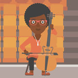 Woman playing cello. An african-american woman playing cello on the background of empty theater seats vector flat design illustration. Square layout Stock Photo