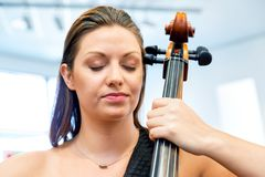 Woman playing cello royalty free stock images