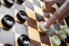 Woman Playing Checkers Stock Photography