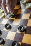 Woman Playing Checkers Stock Photo
