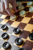 Woman Playing Checkers Stock Photos