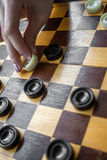 Woman Playing Checkers Royalty Free Stock Images