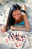 Woman playing chess Stock Photography