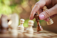 Woman playing chess Stock Photos