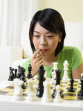 Woman playing chess Royalty Free Stock Photography