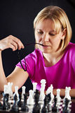 Woman playing chess Stock Photo