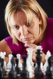 Woman playing chess Stock Image