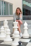 Woman playing chess game. Stock Images