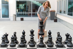 Woman playing chess game. Stock Image
