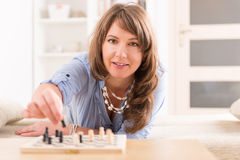 Woman playing chess at home Royalty Free Stock Photo