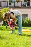 Woman playing with child outdoors Stock Photography