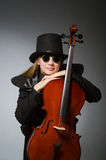 The woman playing classical cello in music concept Stock Photos