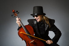 The woman playing classical cello in music concept Royalty Free Stock Photo
