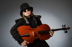 The woman playing classical cello in music concept Royalty Free Stock Image