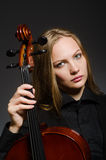 The woman playing classical cello in music concept Stock Photography