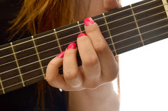 Woman playing a classical guitar Stock Image