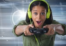 Woman playing with computer game controller with motion background. Digital composite of woman playing with computer game controller with motion background Stock Photos