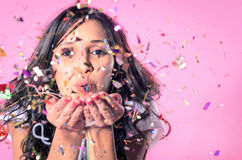 Woman playing with confetti Royalty Free Stock Photography