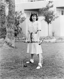 Woman playing croquet in the yard Royalty Free Stock Images