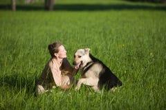 Woman playing dog Royalty Free Stock Image