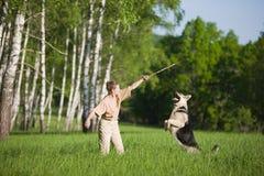 Woman playing dog stock image