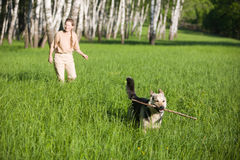Woman playing dog Royalty Free Stock Photo