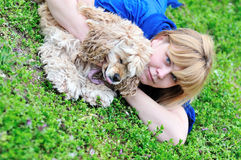 Woman playing with dog Stock Image