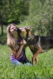 Woman playing with dog in park Stock Photography