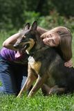 Woman playing with dog in park Stock Photo