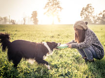 Woman playing with dog Stock Photo