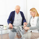 Woman playing domino with senior Royalty Free Stock Image