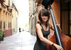 Woman playing double bass on Royalty Free Stock Photography