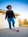 Woman playing in driveway Royalty Free Stock Images