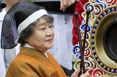 Woman playing the drum at the Takayama festival, Japan