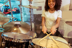 Woman playing drums Royalty Free Stock Photo