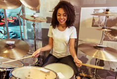 Woman playing drums Stock Images
