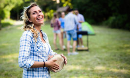 Woman playing drums having fun in nature. Woman playing drums having bbq  fun in nature with friends Royalty Free Stock Images