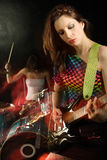 Woman playing electric guitar Stock Image