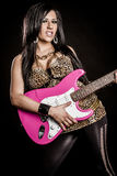 Woman Playing Electric Guitar Royalty Free Stock Images