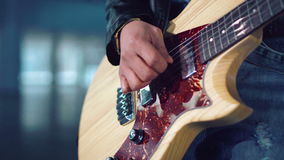 Woman playing electric guitar stock footage