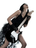 Woman playing electric guitar player. One woman playing electric guitar on studio isolated white background Stock Photo