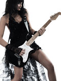 Woman playing electric guitar player. One woman playing electric guitar on studio isolated white background Stock Images