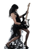 Woman playing electric guitar player. One woman playing electric guitar on studio isolated white background Royalty Free Stock Photo