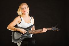 Woman playing on electric guitar and singing Stock Photography