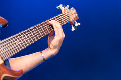 Woman playing an electric guitar Stock Images