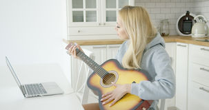 Woman playing electric guitar Royalty Free Stock Photo