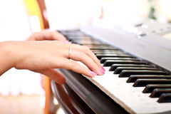 Woman playing on electric piano Royalty Free Stock Images